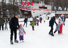 Adults and children skating in park Royalty Free Stock Photos