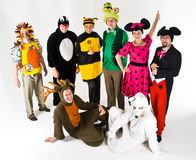 Adults in colorful costumes. A studio view of a group of adults dressed in a variety of colorful costumes Stock Images
