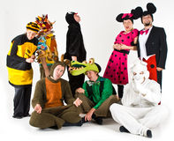 Adults in costume. A studio view of a group of adults dressed in a variety of colorful costumes Stock Image