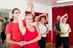 Adults dancing in dance studio Royalty Free Stock Photos