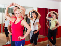 Adults dancing in dance studio. Smiling adults dancing a bachata together in the dance studio Stock Images