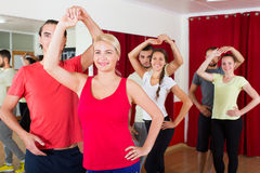 Adults dancing in dance studio. Smiling adults dancing a bachata together at dance studio stock photos