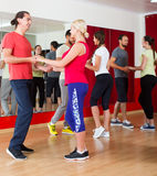 Adults dancing in dance studio Royalty Free Stock Images