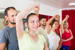 Adults dancing in dance studio. Smiling adults dancing the bachata together at dance studio stock images