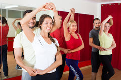 Adults dancing in dance studio