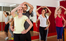 Adults dancing in dance studio Stock Photo