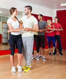 Adults dancing in dance studio Stock Photography