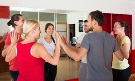 Adults dancing in dance studio. Smiling happy adults dancing bachata together at the dance studio stock photos