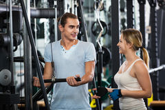 Adults doing powerlifting on machines. Young adults doing powerlifting on machines in a fitness club Stock Photo