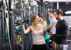 Adults doing powerlifting on machines. Young adults doing powerlifting on a machines at fitness club Stock Photography