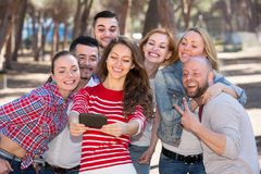 Adults doing selfie outdoors Stock Photo