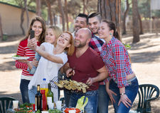 Adults doing selfie at picnic Royalty Free Stock Photography