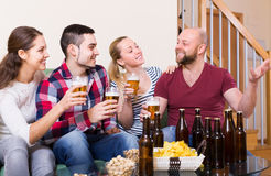 Adults drinking beer indoor Stock Images