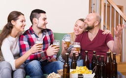 Adults drinking beer indoor Stock Photo