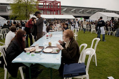 Adults Eating at Public Picnic in PArk. Celebration of the World Fair Trade Day by having a giant, open to all, picnic on the Lawn at La Villette Park, to Stock Image