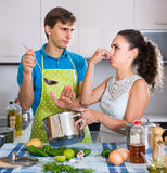 Adults feeling foul smell of food from casserole Royalty Free Stock Photos