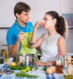 Adults feeling foul smell of food from casserole Royalty Free Stock Images