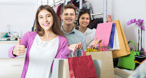 Adults in good mood holding bags at clothing store Royalty Free Stock Photo