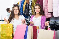 Adults in good mood holding bags at clothing store Stock Photography