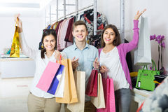 Adults in good mood holding bags at clothing store Stock Image