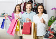 Adults in good mood holding bags at clothing store Royalty Free Stock Photography
