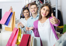 Adults in good mood holding bags at clothing store Royalty Free Stock Images