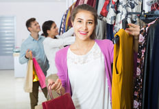 Adults in good mood shopping at the clothing store Stock Images