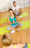 Adults at group yoga practice Stock Photography