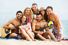 Adults with guitar at beach Royalty Free Stock Image