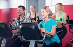 Adults in gym working out at group class Royalty Free Stock Photography
