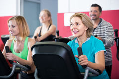 Adults in gym working out at group class Royalty Free Stock Image