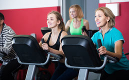 Adults in gym working out at group class Royalty Free Stock Photos