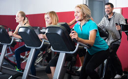 Adults in gym working out at group class Royalty Free Stock Photo