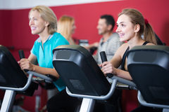 Adults in gym working out at group class Stock Photo