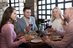 Adults having dinner in restaurant Stock Photography