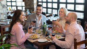 Adults having dinner in restaurant Royalty Free Stock Images