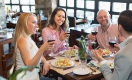 Adults having dinner in restaurant Stock Photo