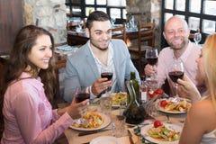 Adults having dinner in restaurant. Positive adults having dinner in family restaurant Stock Photo