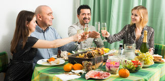 Adults having dinner together Royalty Free Stock Photos