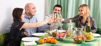 Adults having dinner together Royalty Free Stock Photo
