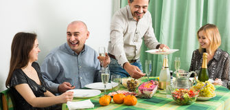 Adults having dinner together Stock Photo