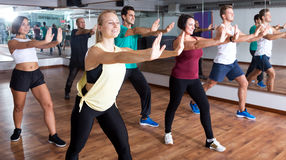 Adults having group fitness class Stock Image