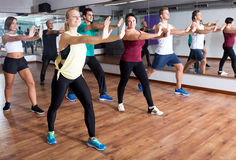 Adults having group fitness class. Glad adults having group fitness class in sport club stock photo