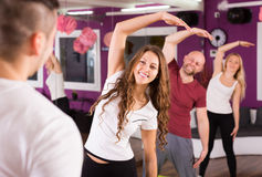 Adults having group fitness class. Happy adults having group fitness class in sport club Royalty Free Stock Photography