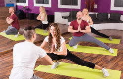 Adults having group fitness class Stock Images