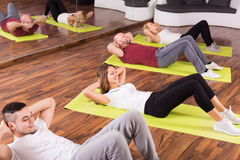 Adults having group fitness class Stock Photos