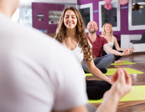 Adults having yoga class. Happy active adults having yoga class in sport club Stock Photos