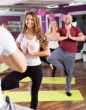 Adults having yoga class Stock Photography