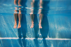 Adults legs underwater in the swimming pool Royalty Free Stock Image