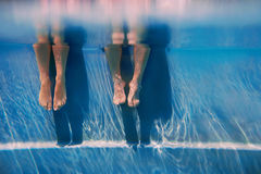 Adults legs underwater in the swimming pool Stock Photography